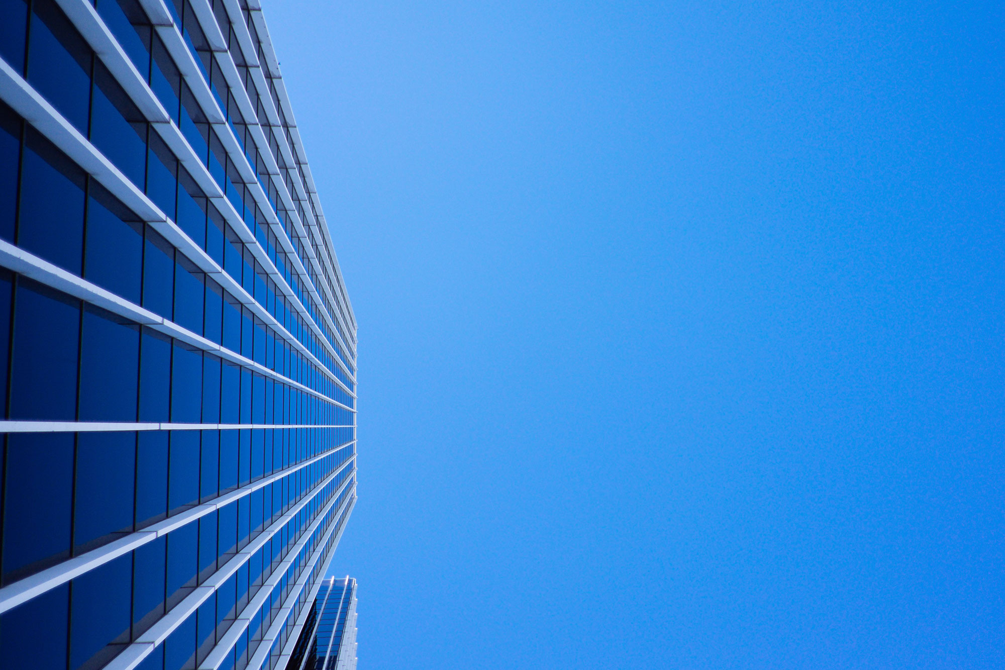 Blue office building with blue sky